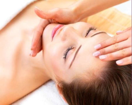 Close-up of a young woman enjoying facial massage